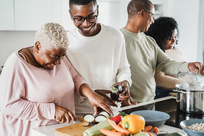 happy-black-family-cooking-inside-kitchen-home-father-daughter-son-mother-having-fun-preparing-lunch-main-focus-boy-face